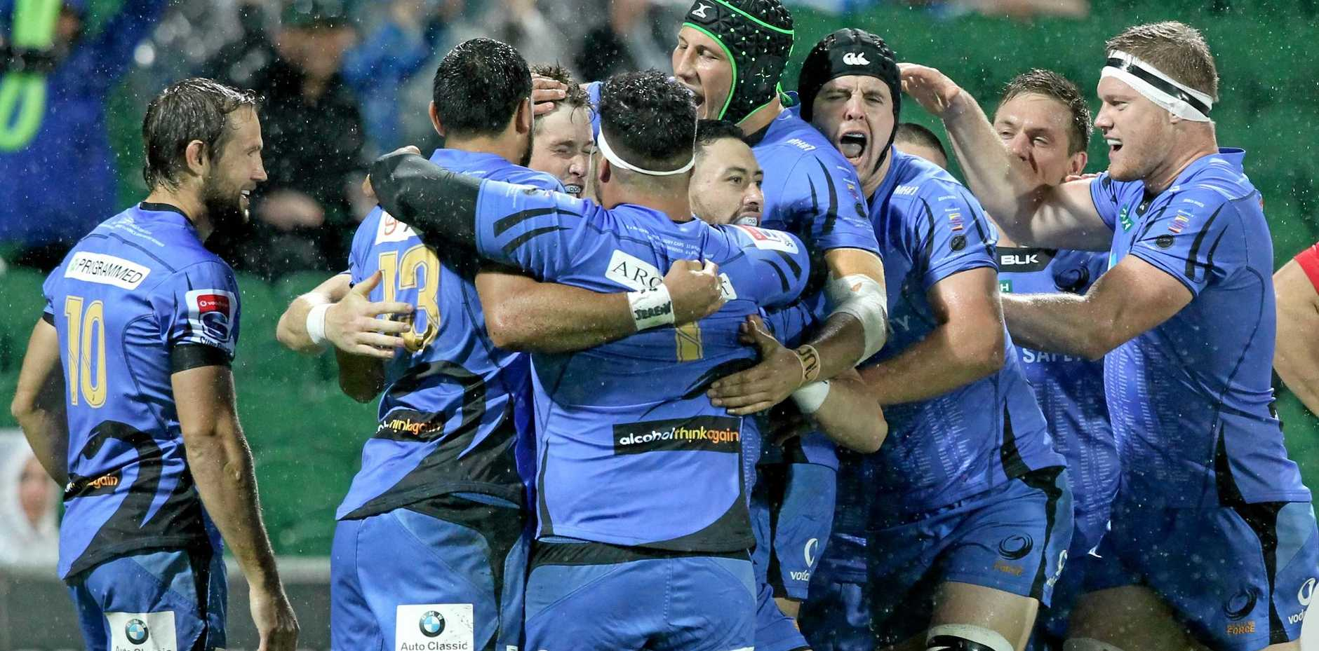 Western Force players celebrate a try during the round 17 Super Rugby match against the NSW Waratahs at nib Stadium in Perth.