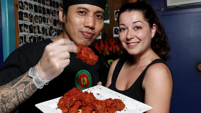 Chef Ryan Daruca and bar manager Hazel Jenkins at the Green Ant Cantina with a serving of Wings of Death. PICTURE: STEWART McLEAN