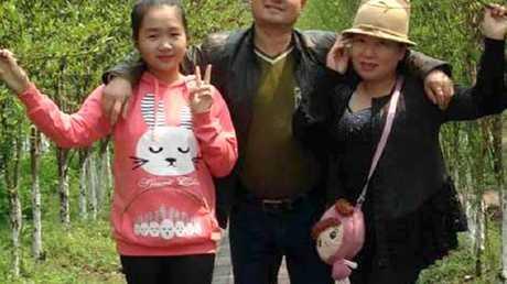 Xinyu Yuan with her father Zheng Chuan Yuan and mother Ma Li Dai. Picture: Supplied