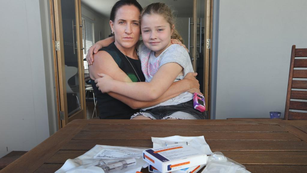 Selena Tranter with seven-year-old daughter Lilly at their Miami home. Selena has concerns about a possible bad batch of insulin that is causing issues for people with diabetes. Photo: Glenn Hampson