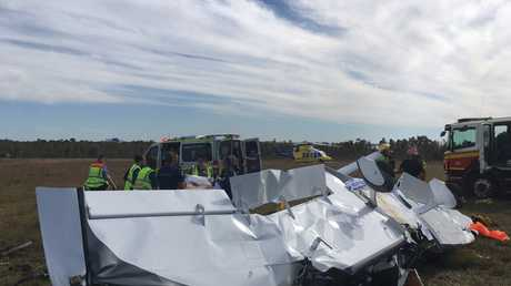 The wreckage of a light plane that crashed at Caloundra Aerodrome.