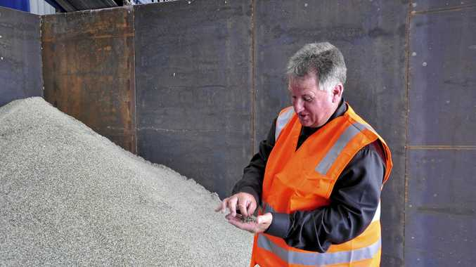 Rockhampton Councillor Neil Fisher with glass fragments which have been recycled and refined to become construction bedding sand. Photo Michelle Gately / Morning Bulletin