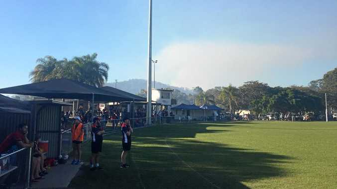 HAZE: Thick smoke can be seen and smelled from the oval at Boyne Island Tannum Sands.