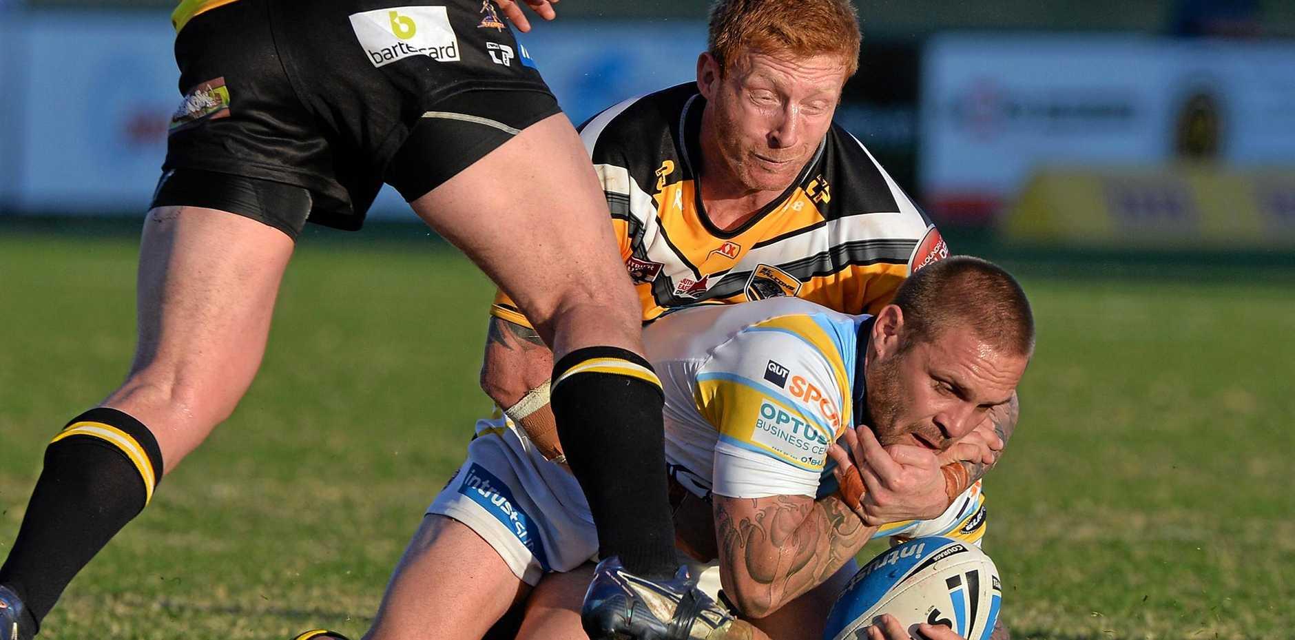DEFEATED: Sunshine Coast captain Dane Hogan tackles Norths' Danny Kerr.
