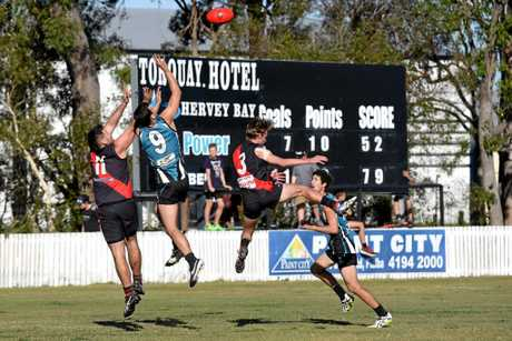 Bay Power's Ben Ottery leaps above Hervey Bay Bomber (left) James Hickey. QFA Wide Bay Sunshine Coast elimination final: Bay Power v Hervey Bay Bombers at Keith Dunne Oval, Hervey Bay.
