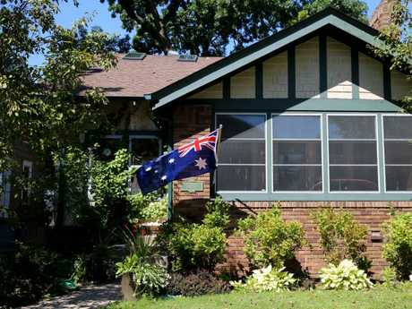 An Australian flag flies outside the home of Justine and Don Damond. Picture: Nathan EdwardsSource:News Corp Australia