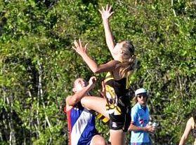 Bakers Creek Tigresses' Lauren Bella goes up in ruck.