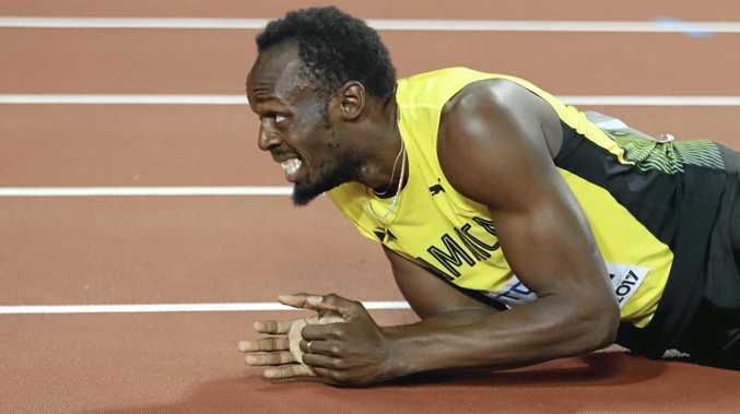 Jamaica's Usain Bolt lies on the track after injuring himself