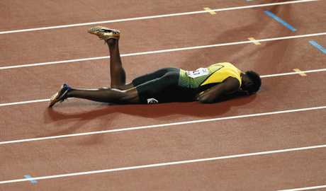 Bolt lays on the track