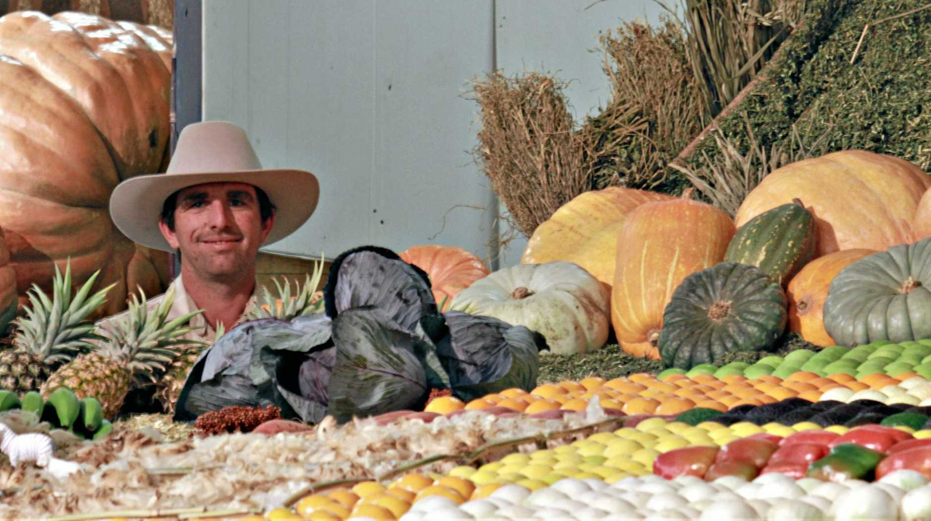 Darling Downs District Exhibit volunteer Jonathan Fawkes is teaching Ekka patrons about our region's produce.
