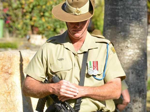 A soldier from the Gympie based ninth Royal Queensland Regiment stands guard at the Vietnam Veterans Day service in Gympie this afternoon.