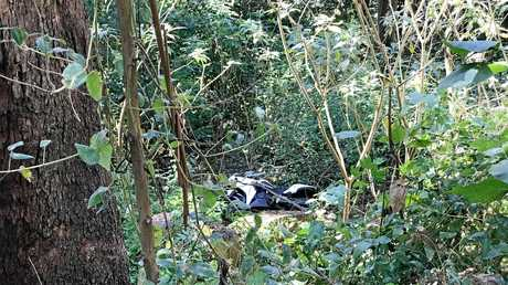 The 20-year-old rider's motorcycle was flung into dense bushland.