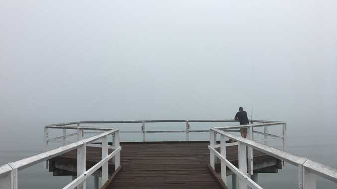 The view from Scarness Jetty is obstructed by heavy fog about 9am.
