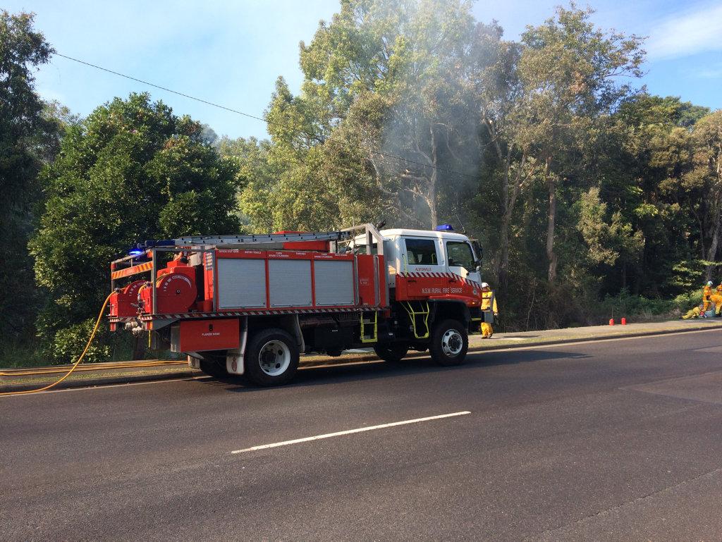 Fire crews monitoring a bushfire at East Ballina.