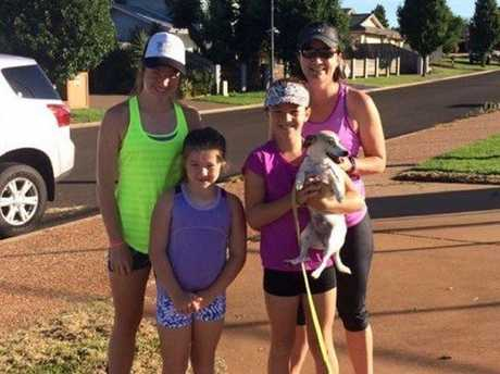 Holly, Ruby and Lucy Anlezark and their mother Angela Sanderson with Pebbles.