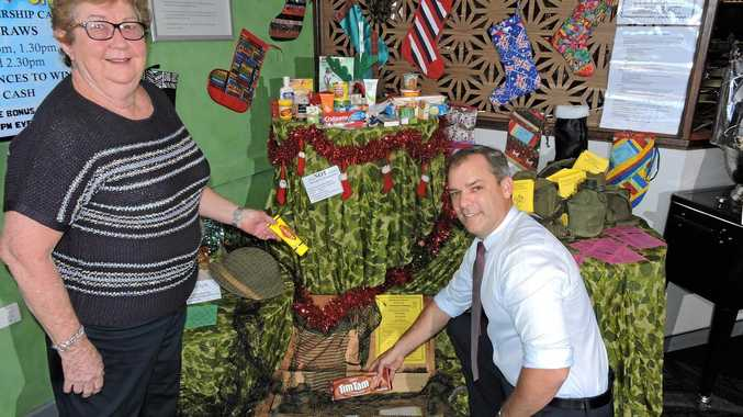 Maryborough Artisan Lesley Mason and Maryborough RSL CEO Jason Scanes at the Craftfest Community Challenge display at the RSL encouraging patrons to sew a Christmas stocking to be given to the Christmas Care Packages sent to Australia troops serving overseas.