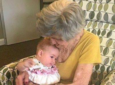 BABY LOVE: Little Lola brings a new level of enjoyment to dementia sufferer Morleen at Feros Care Bangalow Residential Village.