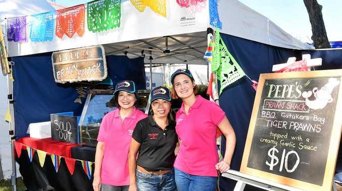Pepe's Prawn Shack's Cora Reid, Susan Possumah and Alana Lewthwaite sold out of their tiger prawns dish.