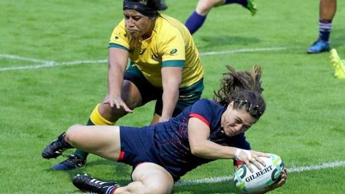 Chloe Pelle goes over for a try against the Wallaroos.