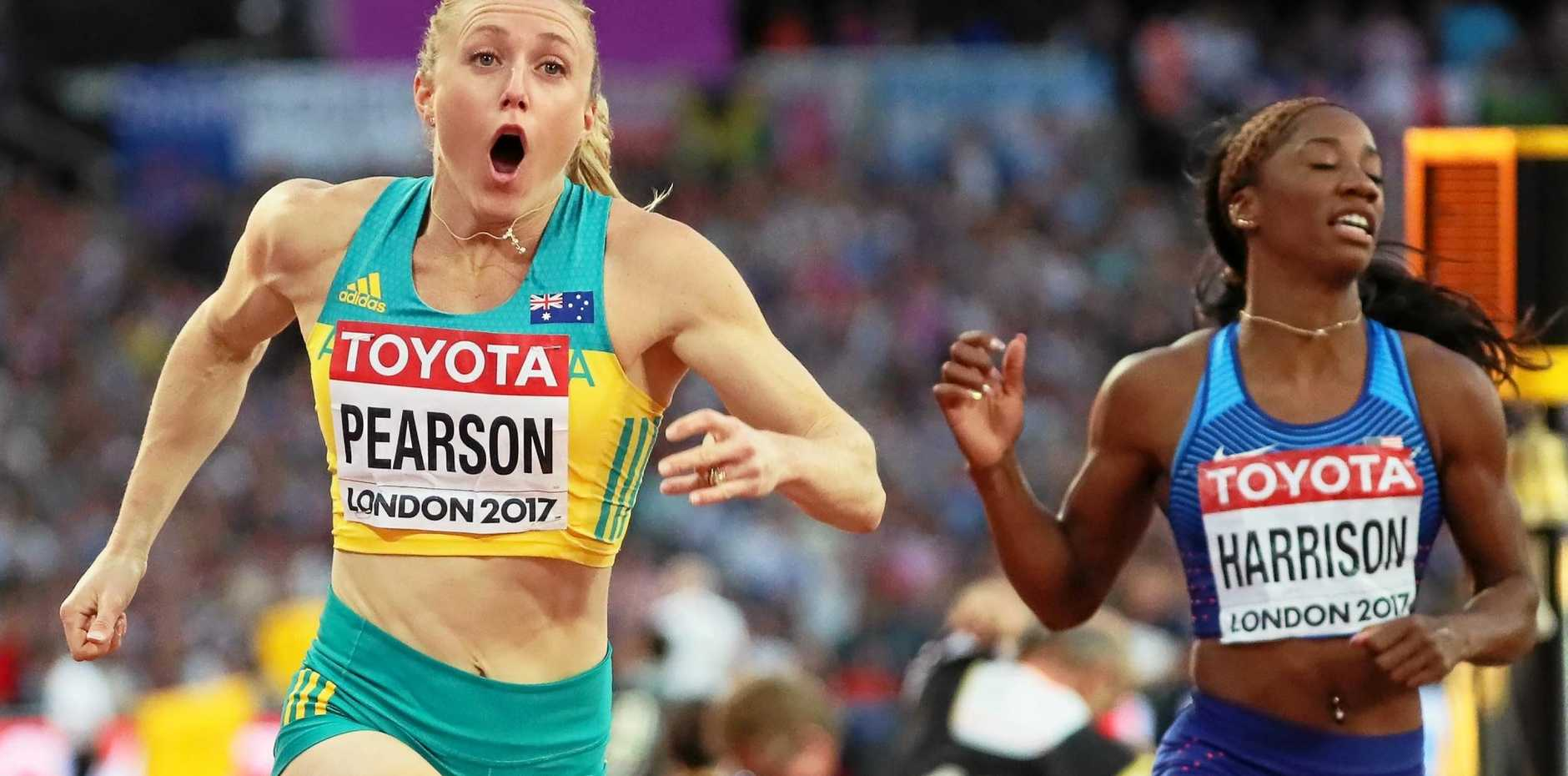 Sally Pearson (L) reacts after crossing the finish line to win the women's 100m Hurdles final