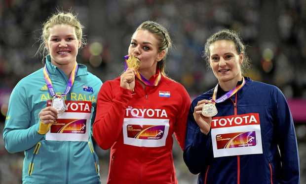 Women's discus gold medalist Croatia's Sandra Perkovic, centre, stands with silver medalist Australia's Dani Stevens, left, and bronze medalist France's Melina Robert-Michon, right