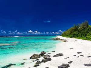 HOLIDAY HEAVEN: Amazing beaches with white sand and black rocks on Rarotonga, Cook Islands.