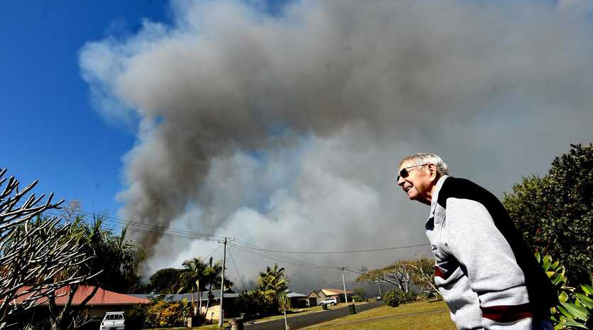 ON ALERT: East Ballina resident Allan Hay has lived in the area for 40 years and watches to see what the bushfire is doing as smoke piles into the air.