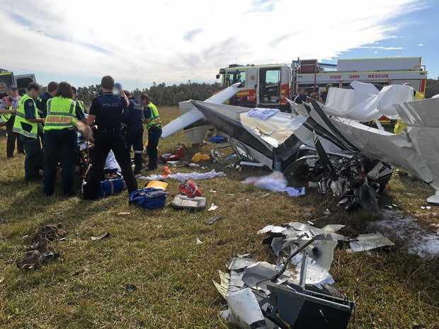 The wreckage of a light plane that crashed at Caloundra Aerodrome.