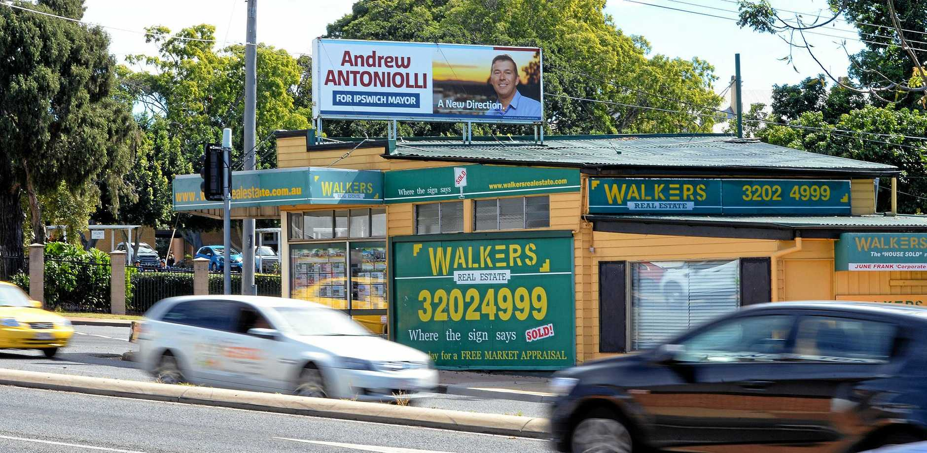 Andrew Antoniolli sign on Walkers Real Estate at the Ipswich Fiveways.