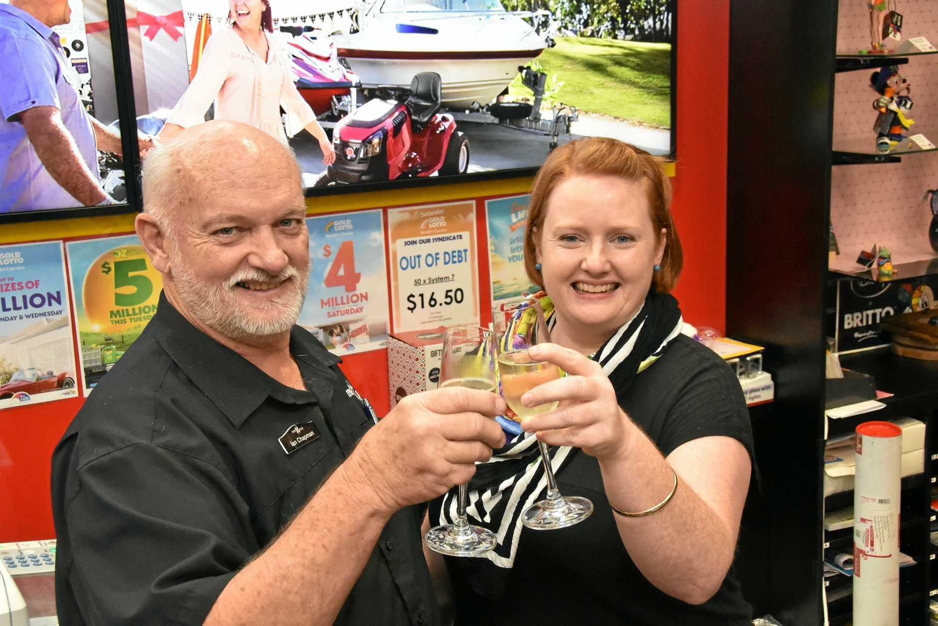 LUCKY STRIKE: Ian Chapman and Sarah Coombs at newsXpress Kin Kora hope to sell more winning tickets .