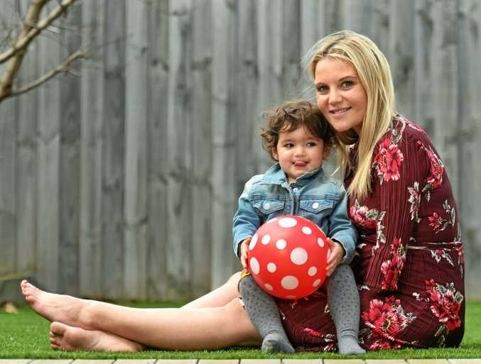 IN THE MOMENT: Jessica Smith with daughter Ayla, 2. Jessica, who was born with only one arm, is pregnant with her second child and says motherhood has been her greatest challenge.