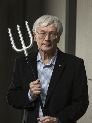 "Dick Smith holding his pitchfork — a prop he intends to use to warn pollies of the ""revolution"" brewing. Picture: Ross Swanborough"