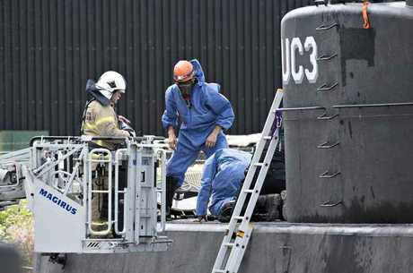 Police technicians prepare to enter the Nautilus after it was salvaged at the weekend. Picture: AFP PHOTO / Scanpix Denmark and Scanpix / Jens Noergaard LarsenSource:AFP