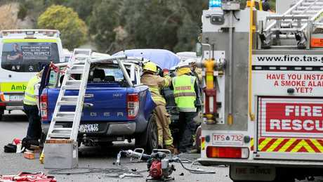 Resucers work to free the trapped driver of a Ford Ranger. Picture: SAM ROSEWARNE