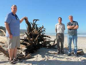 CALL TO CLEAN BEACHES: Ballina's Brian Mullens (left), Phil Robbins (centre) and Peter Campbell want to see Ballina Shire Council clean up the flood debris on local beaches.
