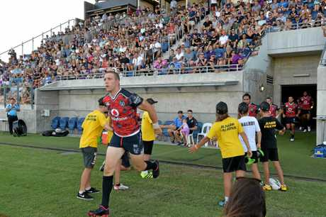 PACKED HOUSE: New Zealand Warriors against Melbourne Storm at the Sunshine Coast Stadium.Warriors' Ryan Hoffman runs out.