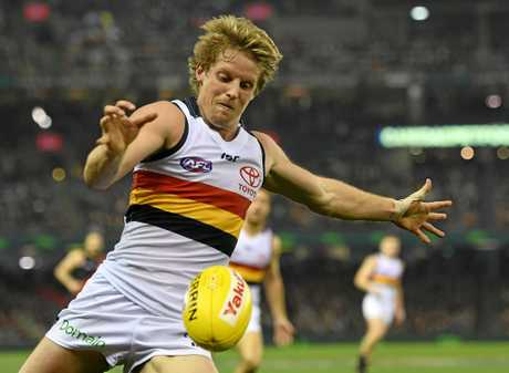 Rory Sloane of the Crows is battling to be fit to face the Swans on Friday.