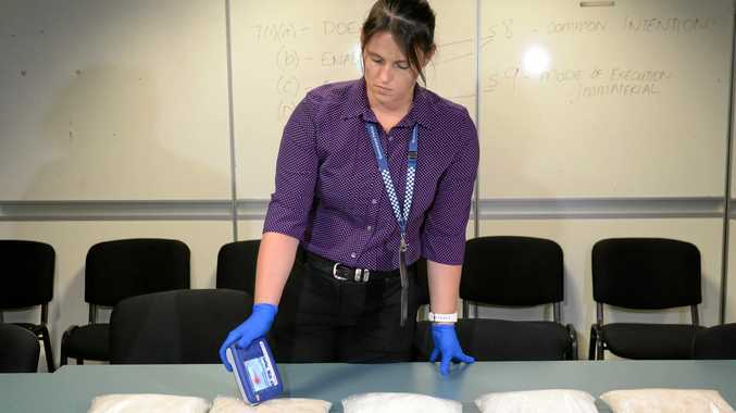 Plain clothes constable Larissa Glacken uses a TruNarc to test drugs.