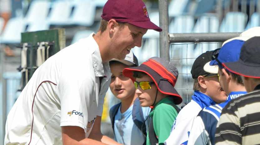 LUCKY FANS: Queensland Bulls bowler Billy Stanlake signs autographs during a break in a Sheffield Shield match.
