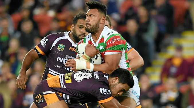Zane Musgrove of the Rabbitohs is tackled by Joe Ofahengaue of the Broncos.
