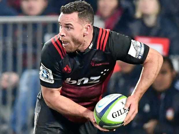 Ryan Crotty of the Crusaders is tackled by Charlie Ngatai of the Chiefs during the Super Rugby semis.