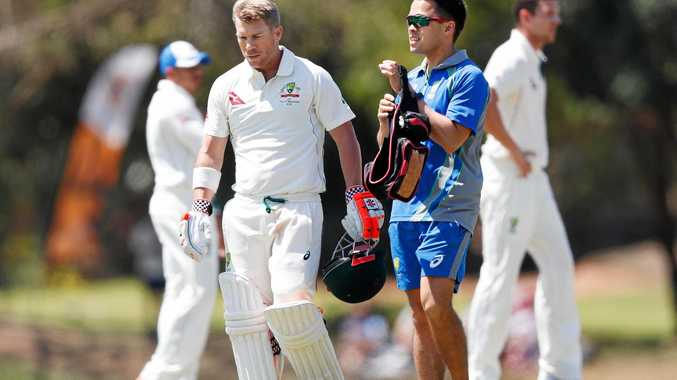 David Warner walks off with the team doctor after being hit by a Josh Hazelwood bouncer.