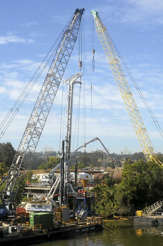 TALL: The   cranes pouring concrete for Grafton bridge.