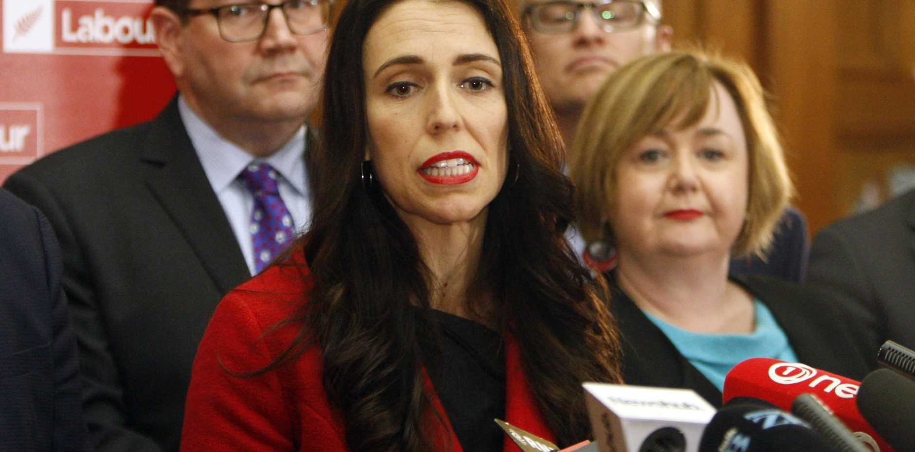 New Zealand Labour Party leader Jacinda Ardern, center, and deputy leader Kelvin Davis, left, answer questions from reporters on Tuesday, Aug. 1, 2017, in Wellington, New Zealand. Former leader Andrew Little announced he was quitting earlier in the day, as the party tries to overcome recent dismal polling seven weeks before the general election. Some believe Ardern will bring more charisma to the