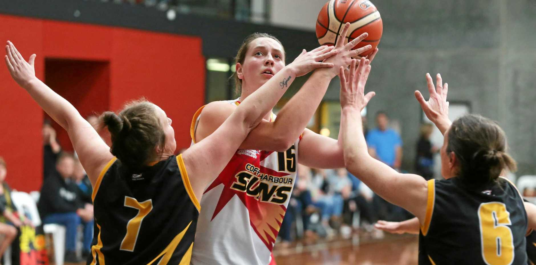 STANDING TALL: Coffs Harbour Suns centre Rachael McGinniskin shoots while under extreme Shoalhaven pressure.