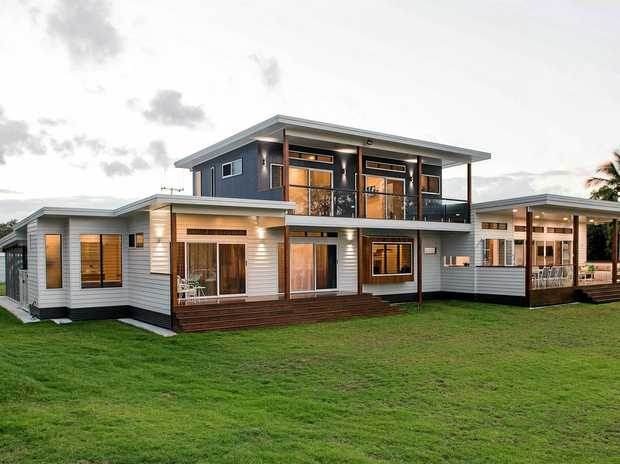 The beautiful beach home, built by Thomsens Builders, on the water's edge at Boonooroo looking over at Fraser Island. Thomsens Builders won House of the Year after entering into the Wide Bay Burnett Housing and Construction Awards.