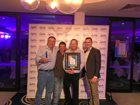 Hutchinsons Builders (from left)  site foreman Mal Campbell, site manager Greg Inwood, project manager Mick Cummings and construction manager Shaun Spry accept the Project of the Year award at the Wide Bay Burnett Housing and Construction Awards.