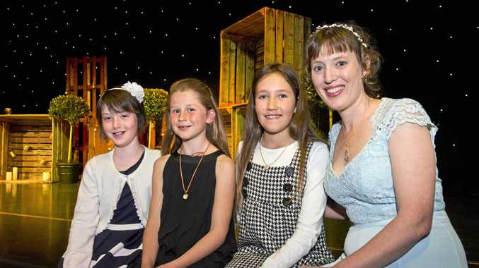 Celebrating the special occasion are (from left) 10-year-olds Corinne Hobbs, Eleise Moody, Emily Brauer and founding chairperson Katrina Hobbs.