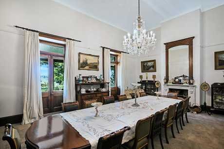 All dining room features tie in with the 19th century, the period the home was built.