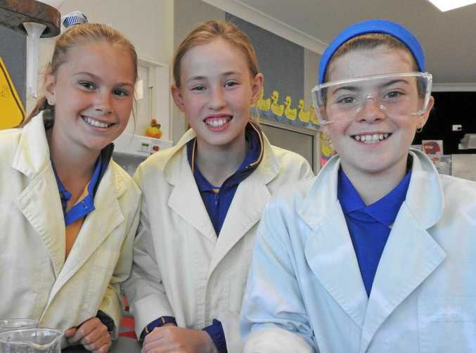 Ramsay State School's morning of science. Young scientists (from left) Emerson Hamblin, Olivia Barnes and Amelia Gaffney are all smiles.